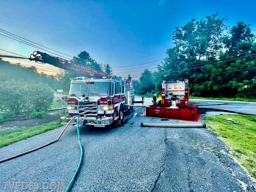 Engine 69-5 dumping into the Fold-a-tank while Ladder 69 drafts