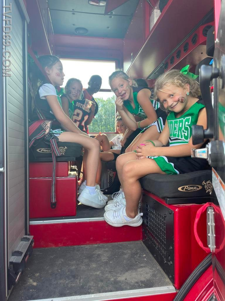 Cheerleaders packing the Rescue Truck.